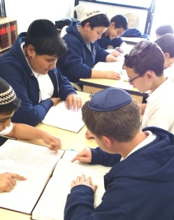 Boys learning in groups in the Beit Hamedrash