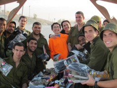 Hillel student Brian Orenshein and Hillel teacher and alumna, Daphne Orenshein with members of the tank unit with their new winter gear