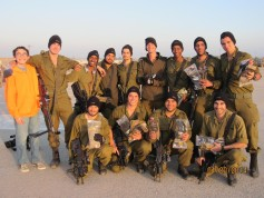 Hillel student Brian Orenshein with members of his brother's tank unit