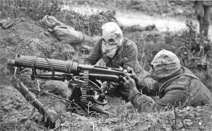 British machine gun crew wearing anti gas helmets