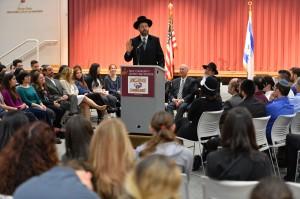 Rabbi Lau speaking at the New Community Jewish High School