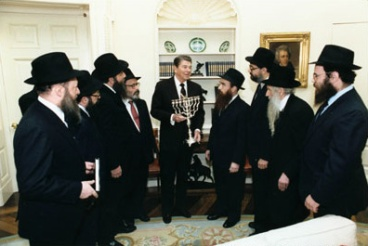 Rabbi Raichik, second from right, along with fellow Chabad Shluchim presenting a Menorah to President Reagan