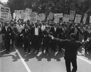 Jewish Civil Rights activist Joseph L. Rauh Jr. marching with MLK in 1963