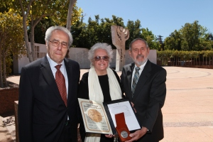 "Mary Garasi-Spitz (at center)  and Louis Garasi (at right) received Yad Vashem's ""Righteous Among The Nations"" honor on behalf of their parents, Louis and Maria Gruber (Garasi) of Budapest, for hiding Luis Spitz (at left) and his family from the Nazis"