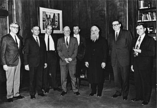 The Sousa Mendes family receiving the Righteus Among the Nations medal at the Israeli Consulate in New York. Left to right: Sebastião Mendes, Luis-Filipe Mendes, Harry Izratty, Moïse Elias, César Mendes, Rabbi Chaim Kruger, Israeli Consul Michael Aron and John Paul Abranches
