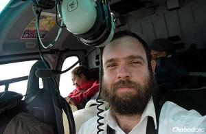 Rabbi Lifshitz in a borrowed helicoptor searching for those stranded by the earthquake