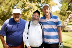 Lou Cvelbar, Rabbi Yonah Landau and Ushi Silverman enjoying some hand rolled cigars at the 11th Hole