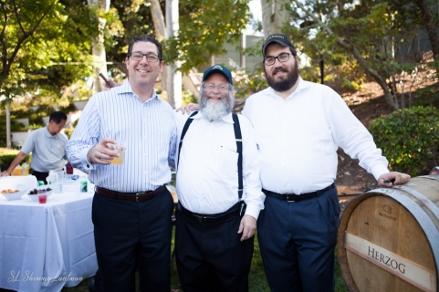 Daniel Samson, Rabbi Yonah Landau and Joseph Herzog enjoy wine from the Barrel from Herzog Wine cellars