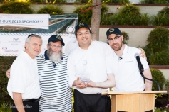 Steve Berger, Rabbi Yonah Landau and Schneur Braunstein presenting the Title Sponsor Yosef Manela with an Award
