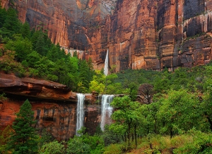 DEKXBY Three waterfalls are produced during a heavy rain at The Emerald Pools at zion National Park