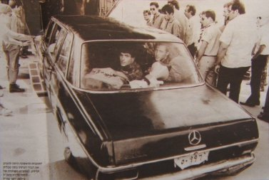 Black Mercedes limousine configured to lookl Like Amin's personal vehicle