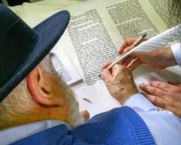 writing a letter at the Kever of Reb Levi Yitzchok M'berditchev