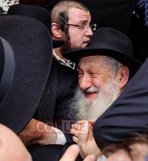 Sholom's father Reb Avrohom Aharon celebrating the night he was released