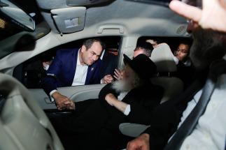 Eli greeting Rav Chaim during the surprise visit